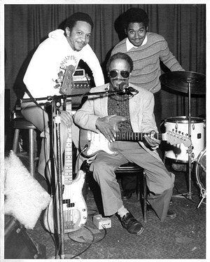 Photo of George Porter, Jr., Snooks Eaglin, and Shannon Powell by Pat Jolly