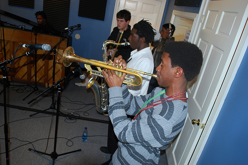 Linton Smith on trumpet, Stephen Gladney on tenor sax, Tyler Ginsberg on trombone, and Shea Pierre on piano.