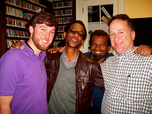 WWOZ phone volunteers Ryan and John from Christian Street Furniture flank drummer Brian Blade and WWOZ program director Dwayne Breashears