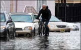 Ken Freedman of WFMU biking in a flooded street