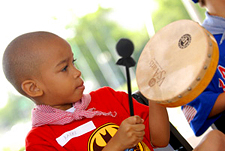 Photo of a child playing a drum