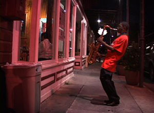 photo of saxophone player outside of Ashé Cultural Center