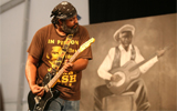 Alvin Youngblood Hart at Jazz Fest 2011.  Photo by Jef Jaisun.