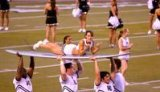 UH Cheerleader on surfboard