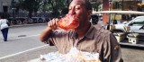 Reggie White of New Orleans shows how to eat a BBQ turkey leg.