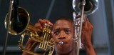 Trombone Shorty with two horns