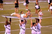 UH Cheerleader on surfboard