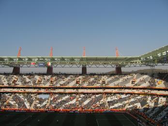 Cross-stadium view of stadium seats form a zebra pattern of black and white