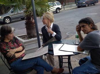 Frank Martorana sitting at an outdoor cafe