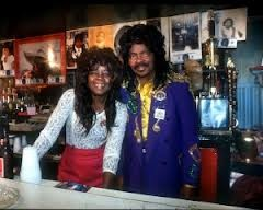 Antonette and Ernie K-Doe behind the bar