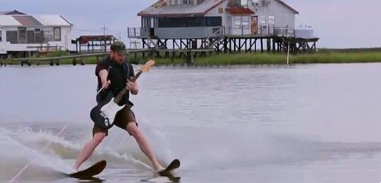 Water skiing guitarist