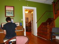 Quintron practicing on piano inside the Guest House before show