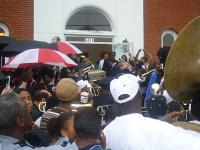 Crowds passed the casket overhead to the carriage at Dinerral Shavers' jazz funeral, January 6, 2007