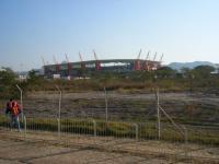 200' orange metal sculptures of giraffes act as stadium supports