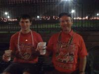 Two Utah fans with Cafe Du Monde food and drink at jackson Square at 1am after the Sugar Bowl.