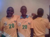 Three guys with South African soccer jerseys all with Hugh Masekela's signature