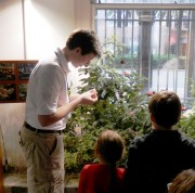 Bug Ambassador educates guests on butterflies in our butterfly garden.