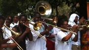 TBC brass band plays en route to Satchmo Fest 2012. Photo by Melanie Merz.