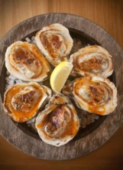 Make Grilled Oysters with Garlic-Chile Butter at home with Chef Link's recipe