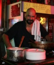 Martin Krusche cooking curry at Saturn Bar. Photo courtesy of Martin.