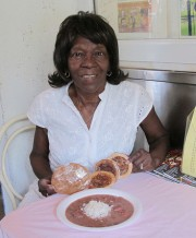 Tee Eva with her famous red beans & rice, pralins and pies. Photo by J. Leslie.