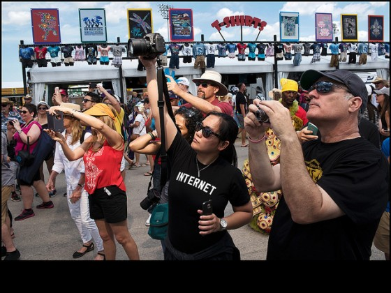 Jazz Fest crowds photographing the Monogram Hunters with Creole Hunters Big Chief Jermaine Bossier in the back ground during day 3. [Photo by Ryan Hodgson-Rigsbee]
