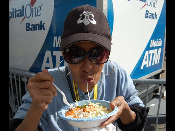 Artist Liaison Dee Lindsay samples some of the delicacies at FQF