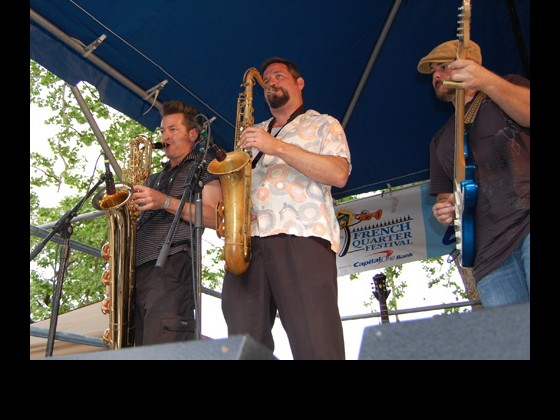 The Honey Island Swamp Band horns and guitarist Chris Mulé