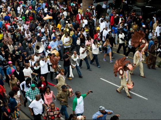 Treme Sidewalk Steppers and Rebirth Brass Band on Claiborne Ave in 2012 [Photo by Ryan Hodgson-Rigsbee]