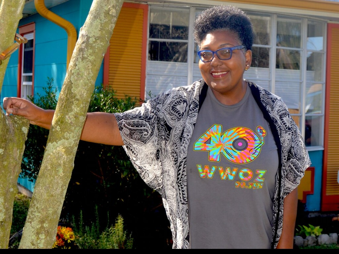 WWOZ Volunteer Coordinator Maryse Dejean models our 40th anniversary T-shirt [Photo by Don Paul]