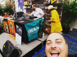 WWOZ volunteer Michael Liuzza photobombs the WWOZ broadcast at IPW 2016