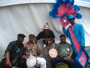 Spy Boy Ricky with David Montana, Monk Boudreaux, Big Chief Hatchet and a member of Keep N It Real at Jazz Fest 2012 [Photo by Sally Young]