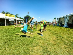 A young fan jumps for joy at Jazz Fest 2016 [Photo by Eli Mergel]