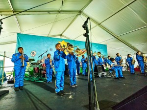 Young Audiences Brass Band performs in the Kids Tent at Jazz Fest 2016 [Photo by Eli Mergel]