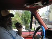 A simple Radio Shack bullhorn brings Okra's call to the neighborhood