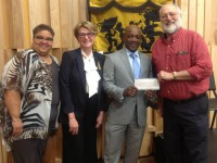 WWOZ's Arthur Cohen (right) and Deb Harkins (second from left) accept the check from Entergy's Customer Service Specialist II and Low Income Champion Demetric Mercadel and Entergy New Orleans President & CEO Charles Rice