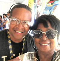 Karen Paige with Donald Lewis (Tuesday WWOZ Livewire reader) at Jazz Fest 2019.